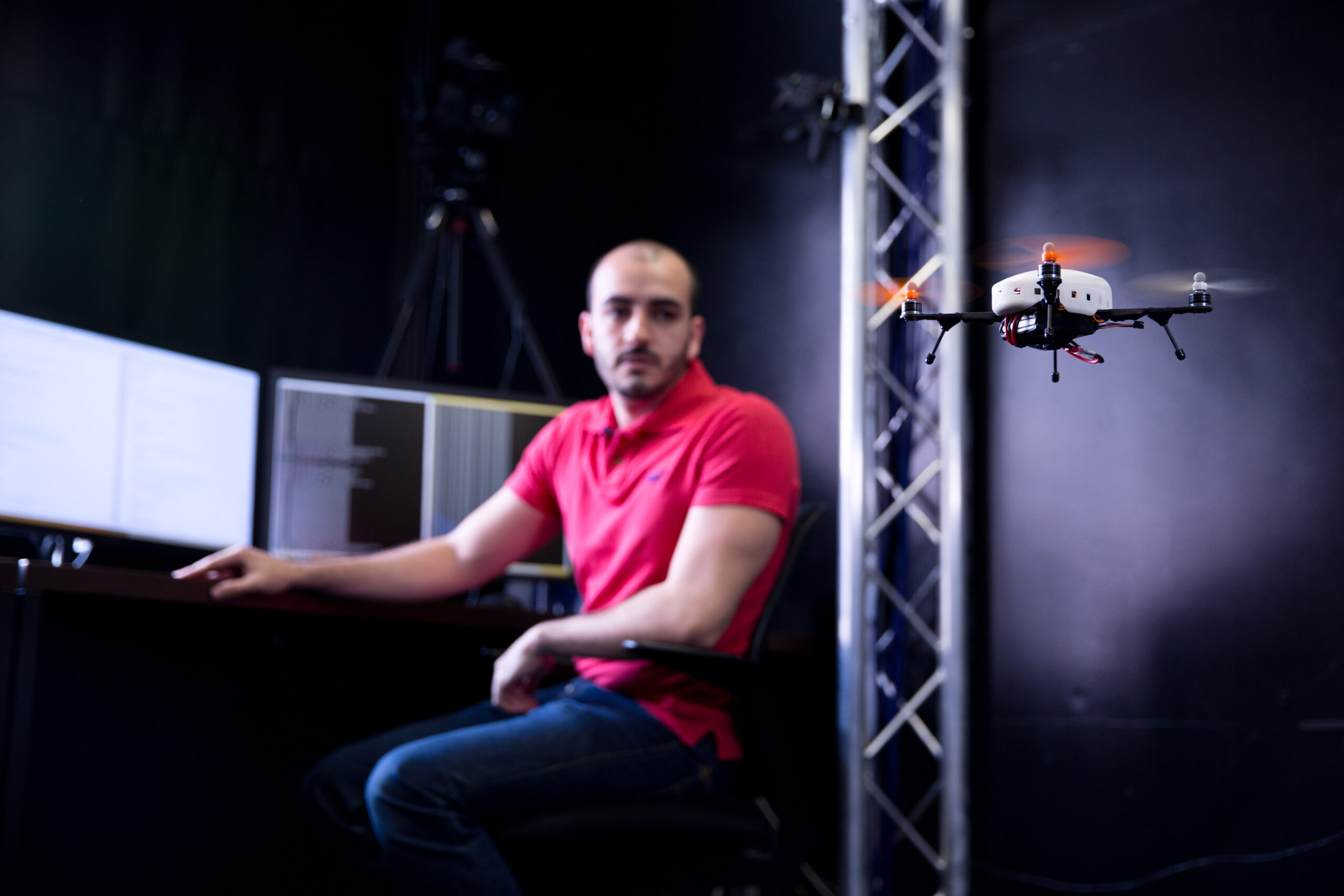 student watches drone flying