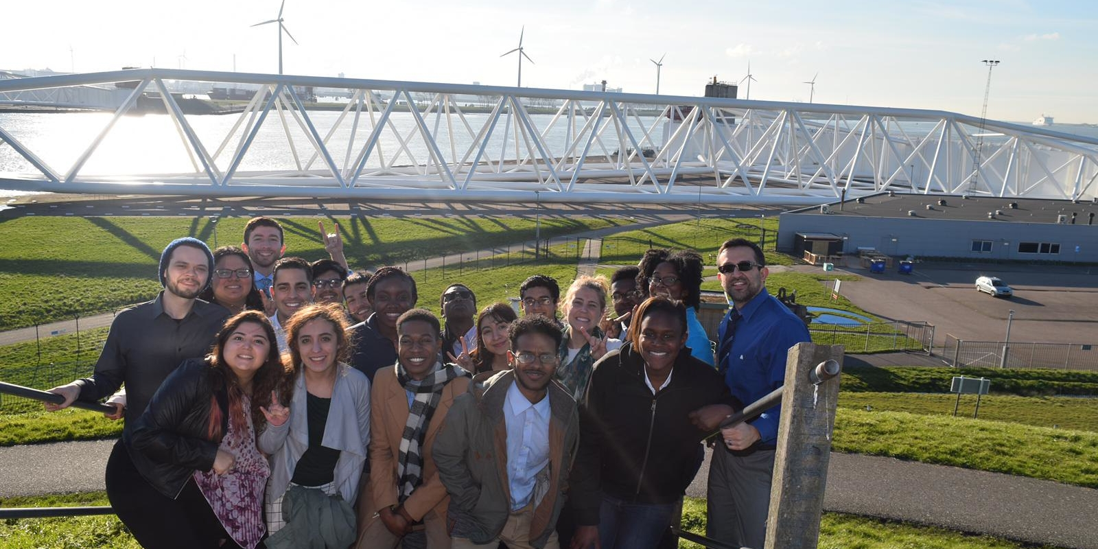 students standing in front of wind turbines in amsterdam
